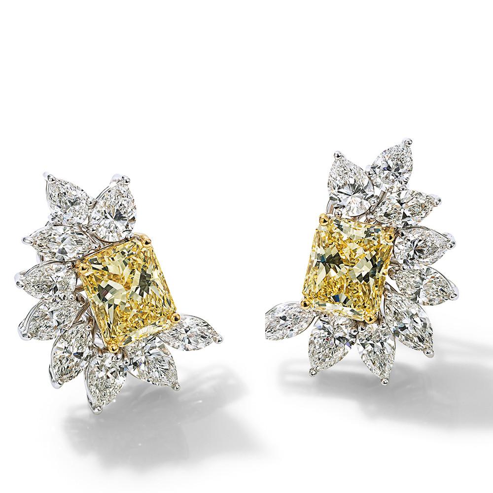 Ohrringe in 750 Weißgold mit Fancy Yellow und weißen Diamanten.