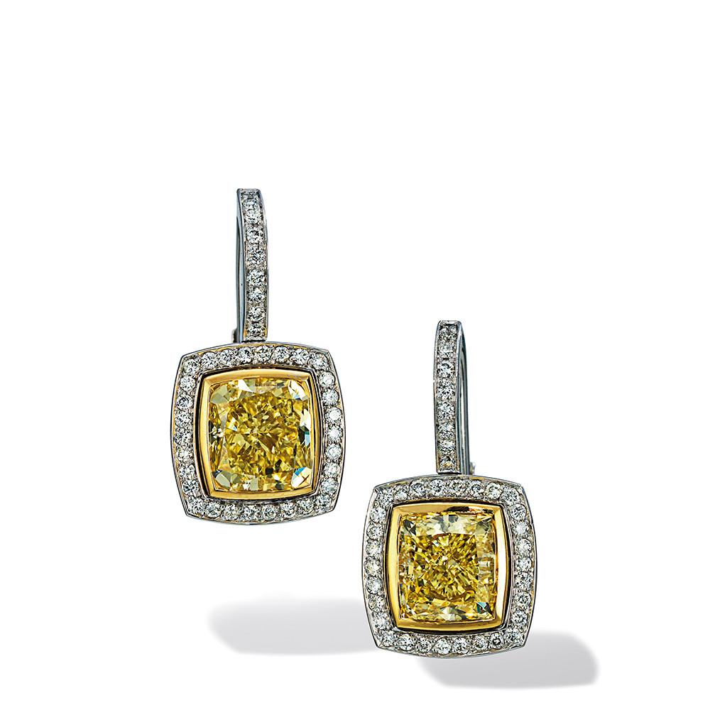 Ohrringe in 750 Weißgold und Gelbgold mit Fancy Yellow und weißen Diamanten.