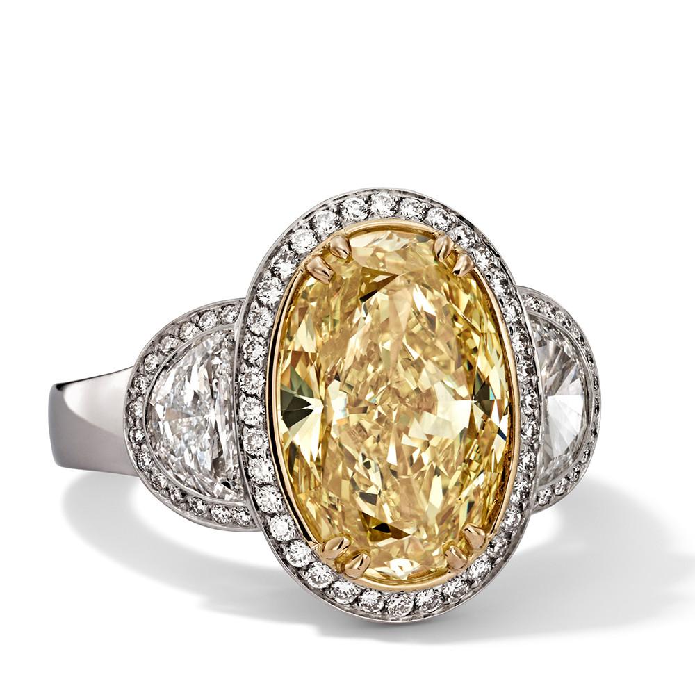 Ring in 750 Weißgold und Gelbgold mit Fancy Intense Yellow und weißen Diamanten. Erhältlich in verschiedenen Größen.