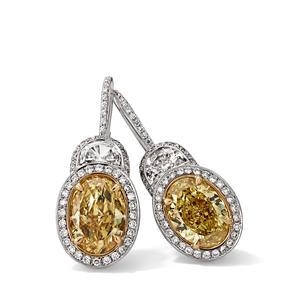 Ohrringe in 750 Weißgold und Gelbgold mit Fancy Intense Yellow und weißen Diamanten.